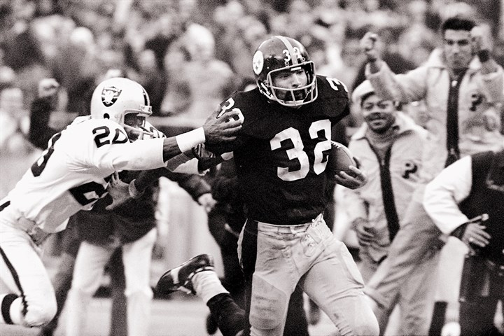 "Immaculate0111 In this Dec. 23, 1972, file photo, Steelers running back Franco Harris (32) eludes a tackle by the Oakland Raiders' Jimmy Ware on the way to scoring the go-ahead touchdown in an AFC playoff game at Three Rivers Stadium. The Steelers won the game, 13-7, on the scoring play, which was dubbed the ""Immaculate Reception."" The play began with a desperation pass by Terry Bradshaw that deflected off either Oakland's Jack Tatum or the Steelers' Frenchy Fuqua before Harris made a shoestring catch."