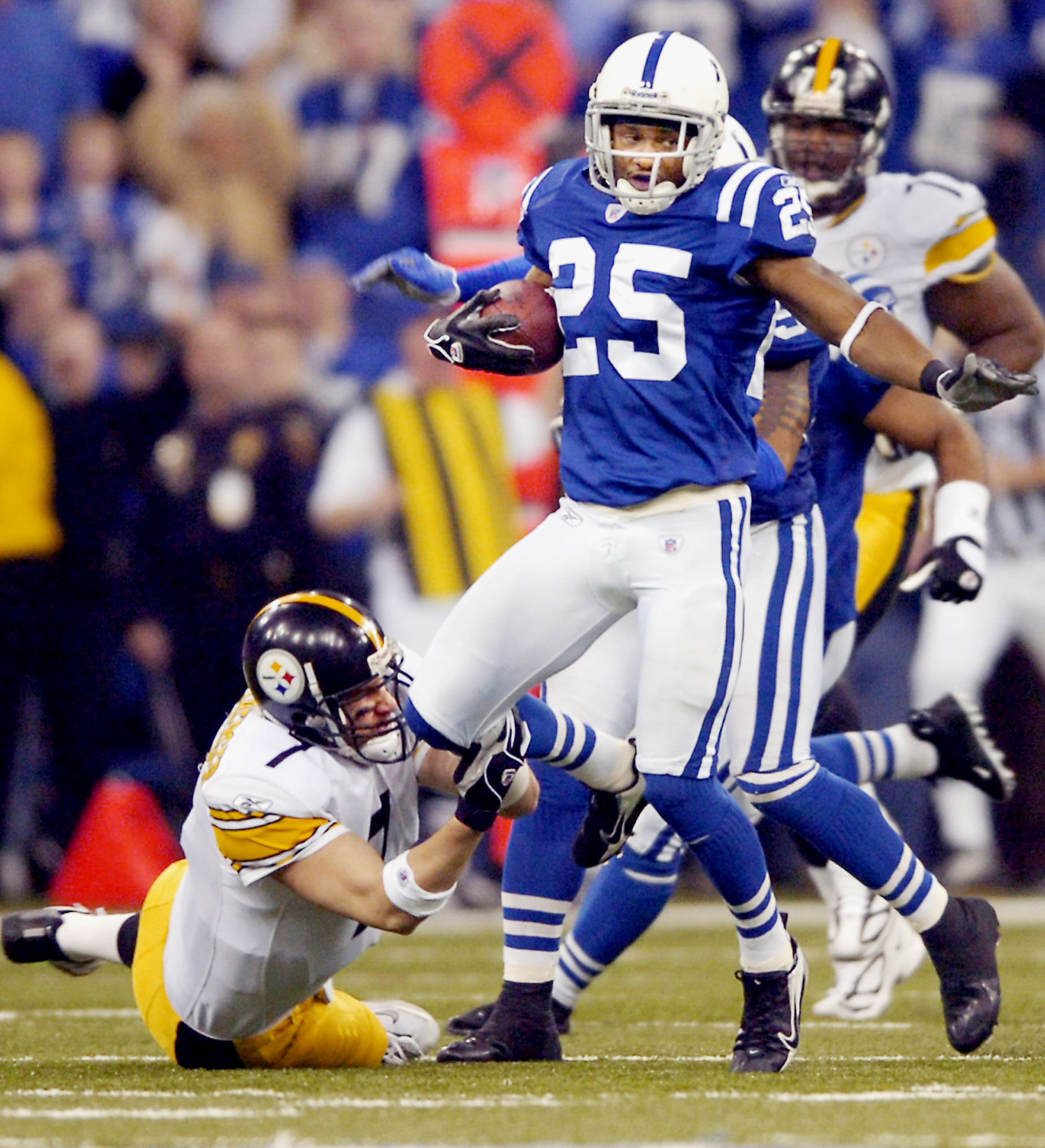 SteelersColts0111b-6 Steelers quarterback Ben Roethlisberger makes the saving tackle on Colts' Nick Harper after a Jerome Bettis fumble late in the fourth quarter in January 2006 in Indianapolis. The Steelers defeated the Colts 21-18 and eventually mar