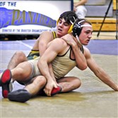 Penn-Trafford's Cameron Coy, back, won the 145-pound title at the Westmoreland County Coaches Association Wrestling Tournament at Franklin Regional.