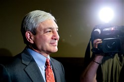 Former Penn State President Graham Spanier exits a hearing before a Superior Court panel in May 2014 at City Hall in Philadelphia.