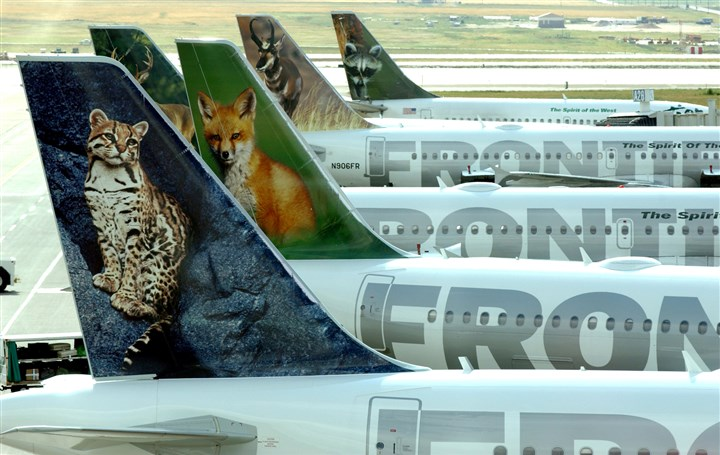 FRONTIER UAL DENVER Frontier Airlines planes stand at their gates at Denver International Airport.