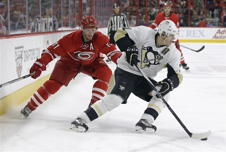 Penguins Hurricanes Hockey Carolina Hurricanes' Jordan Staal chases Evgeni Malkin during the second period.