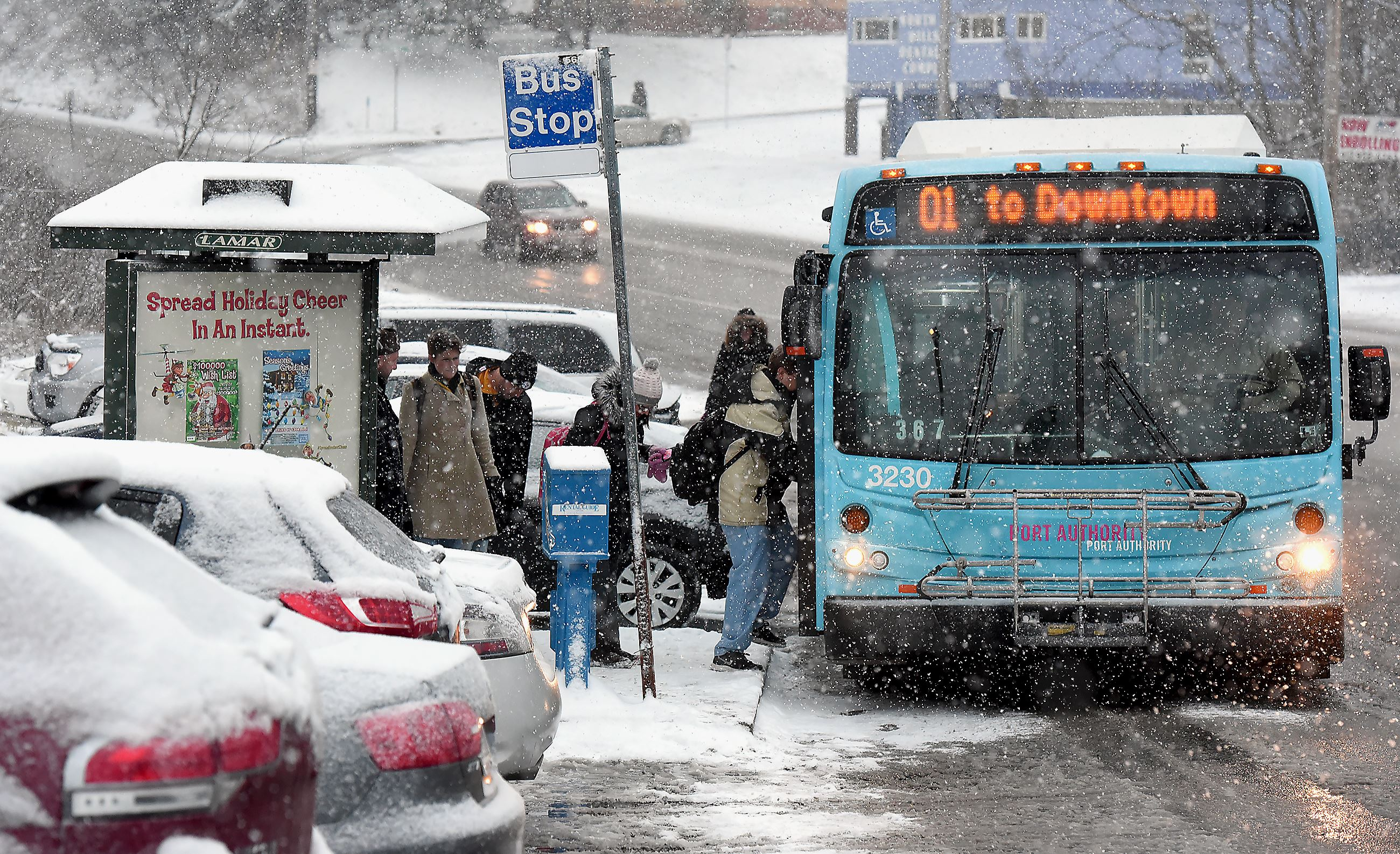 20160112radsnowlocal04 1 commuters board the ross bus at the ross park