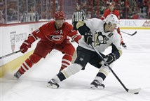 Carolina's Jordan Staal chases Evgeni Malkin during a Jan. 12 game in Raleigh, N.C.