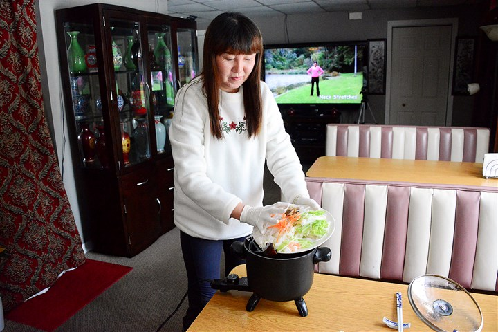 20160113lf-Chinese02-3 Lacy Cai prepares a Tang Dynasty Spicy hot pot at her restaurant, the Mountain Palace Northern Chinese Eatery in Bolivar, Westmoreland County.
