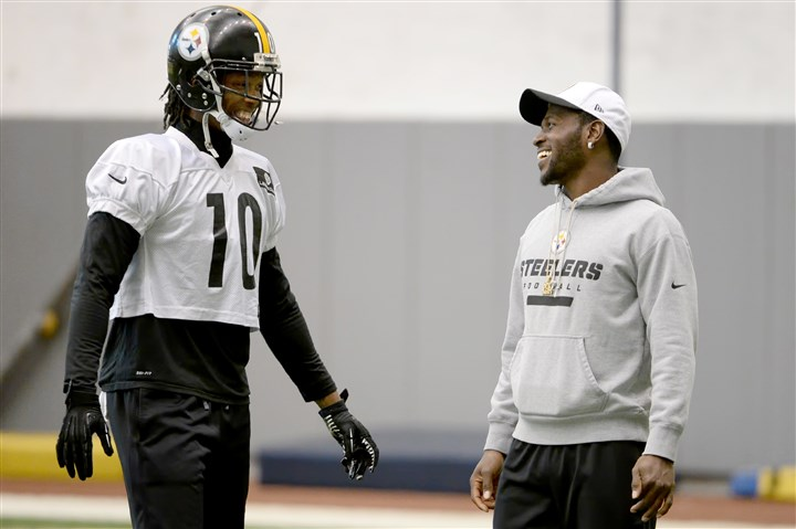 20160113mfsteelerssports03-2 The Steelers' Martavis Bryant talks with Antonio Brown during practice Wednesday on the South Side.