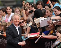 "Alan Rickman signs autographs as he arrives for the North American premiere of ""Harry Potter and the Deathly Hallows Part 2"" at Lincoln Center in New York in July 2011."