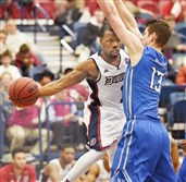 Duquesne's Derrick Colter, left, drives to the basket against Saint Louis Wednesday night at Palumbo Center. Colter led the Dukes with 17 points