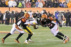 Bengals linebacker Vontaze Burfict, right, effectively knocked the Steelers out of the playoffs after a violent hit on star receiver Antonio Brown, center, which knocked him out of the game.