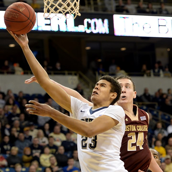 20160116mfpittsports06-1 Pitt's Cameron Johnson drives to the net against Boston College's Dennis Clifford in the second half Saturday at Petersen Events Center.