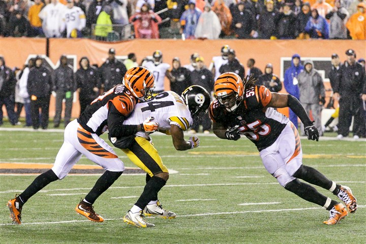 20160116apBrown Cincinnati Bengals' Vontaze Burfict, far right, runs into Antonio Brown during the teams' wild-card playoff football game on Jan. 10.