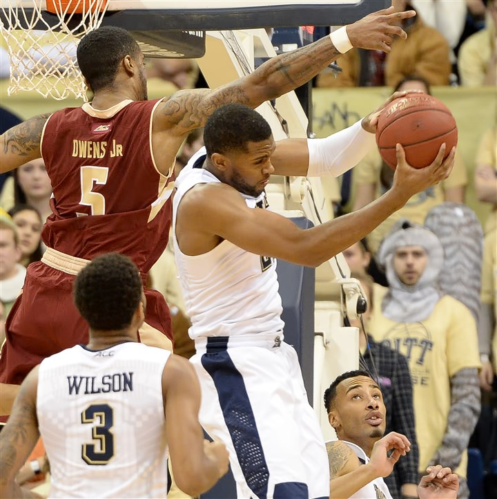 20160116mfpittsports01 Pitt's Sheldon Jeter pulls down a rebound against Boston College's Garland Owens at Petersen Events Center. Jeter was discussed with a concussion and will not play against Florida State.