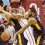 West Virginia's Jaysean Paige, right, knocks the ball away from Oklahoma's Ryan Spangler in the second half Saturday in Norman, Okla. Paige scored 18 points, but the Mountaineers lost to the No. 2 Sooners, 70-68.