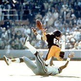 Lynn Swann dives for a catch from Steelers quarterback Terry Bradshaw during Super Bowl X at the Orange Bowl in Miami.