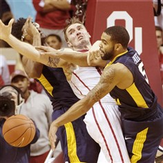 wvu0117C West Virginia's Jaysean Paige, right, knocks the ball away from Oklahoma's Ryan Spangler in the second half Saturday in Norman, Okla. Paige scored 18 points, but the Mountaineers lost to the No. 2 Sooners, 70-68.
