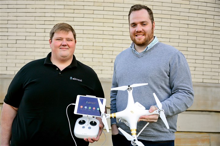 20151204lf-Drone01 Co-founders Justin Miller, left, and Ben Brautigam of Airnest. The new app Airiest allows you to draw a flightpath with your finger and the drone flies on autopilot capturing video or still images.