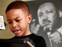 "Joden Merrell, 7, of Churchill takes his turn at ""King for a Day"" by reciting part of Martin Luther King Jr.'s ""I Have a Dream"" speech Monday at the Children's Museum of Pittsburgh."