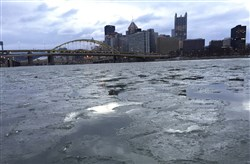 Pieces of ice in the Allegheny River pass in front of Heinz Field.