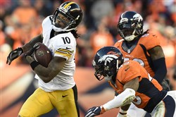 Steelers receiver Martavis Bryant breaks away from Broncos safety T.J. Ward during a playoff game last season in Denver.