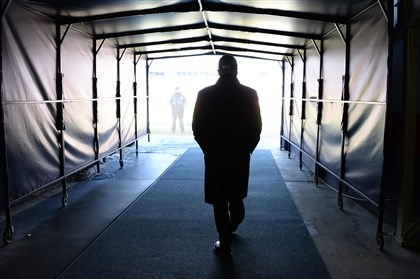 Steelers President Art Rooney II makes his way to the field before the Steelers' divisional round playoff game Jan. 17 against the Broncos at Sports Authority Field at Mile High in Denver.