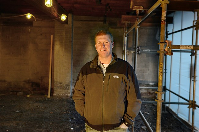 Brooks Broadhurst, former senior vice president of food and beverage for Eat'n Park, stands in what will become Block 292, a sustainable foods market and restaurant in Mt. Lebanon.