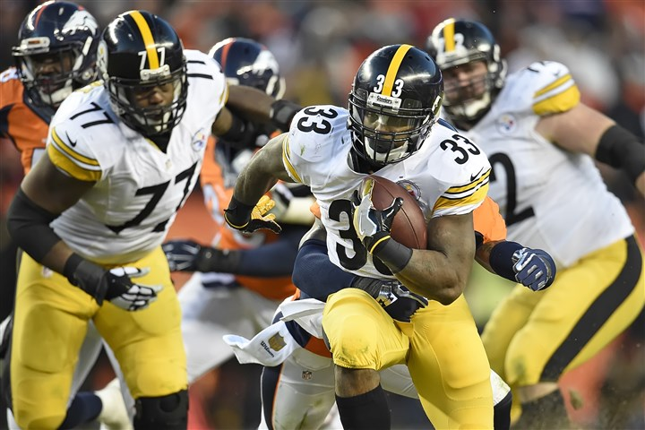 20160117pdSteelersSports20 Steelers running back Fitzgerald Toussaint picks up yardage against the Broncos during an AFC playoff matchup in January.