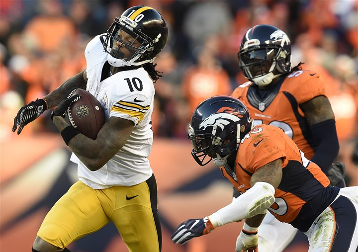 20160117pdSteelersSports19-1 Martavis Bryant breaks away from Broncos players for a first down in the second half Sunday in Denver.