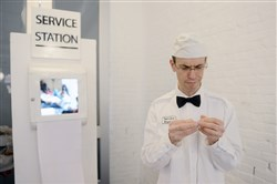 "Dressed as an attendant, Lancaster-based artist William Chambers runs ""Service Station,"" an interactive art project, Monday at the Mattress Factory."