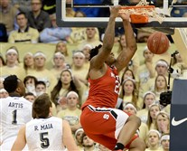 N.C State's BeeJay Anya dunks in front of Pitt's Jamel Artis and Rafael Maia in the first half Tuesday at Petersen Events Center.