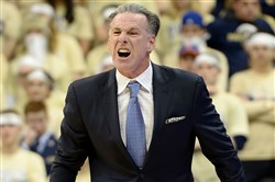 Pitt coach Jamie Dixon reacts after a play during the Panthers' loss Tuesday night against North Carolina State.