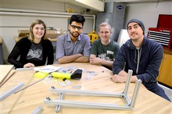 Carnegie Mellon University Hyperloop Team members, from left, Laine Mallet, Himanshu Rasam, Loren Russell and Richard Stavert, all graduate students, pose for a portrait with a preliminary scale pod mockup.