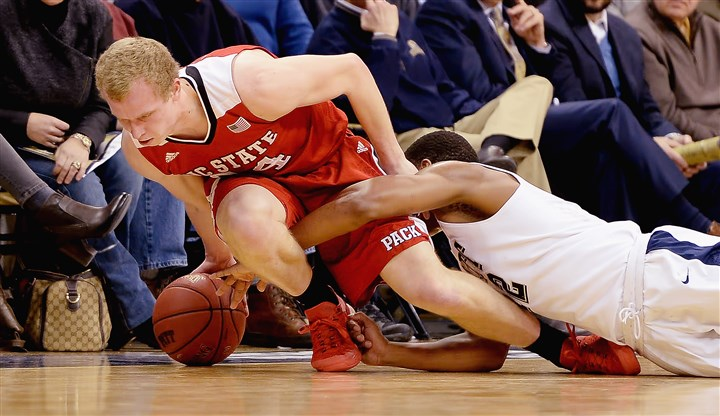 20160119mfpittsports03-1 Pitt guard Chris Jones reaches for a loose ball against N.C. State guard Maverick Rowan Tuesday at Petersen Events Center.