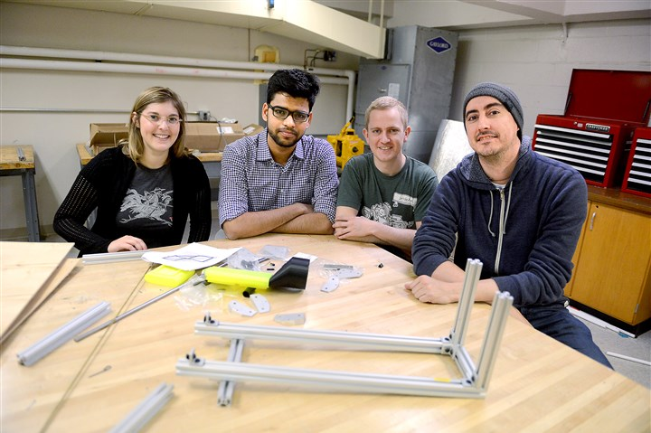 20160119MWHhyperloopScience01 Carnegie Mellon University Hyperloop Team members, from left, Laine Mallet, Himanshu Rasam, Loren Russell and Richard Stavert, all graduate students, pose for a portrait with a preliminary scale pod mockup.