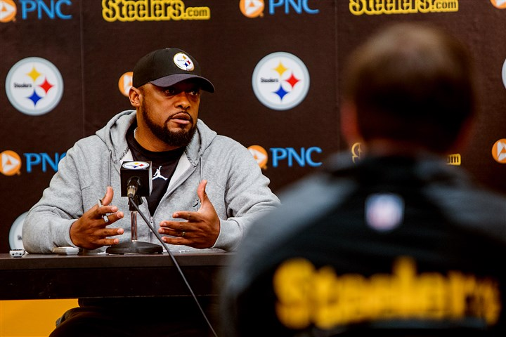 20160120arTomlinNewsConf03-2 Steelers coach Mike Tomlin speaks to the media for his final weekly news conference Wednesday.