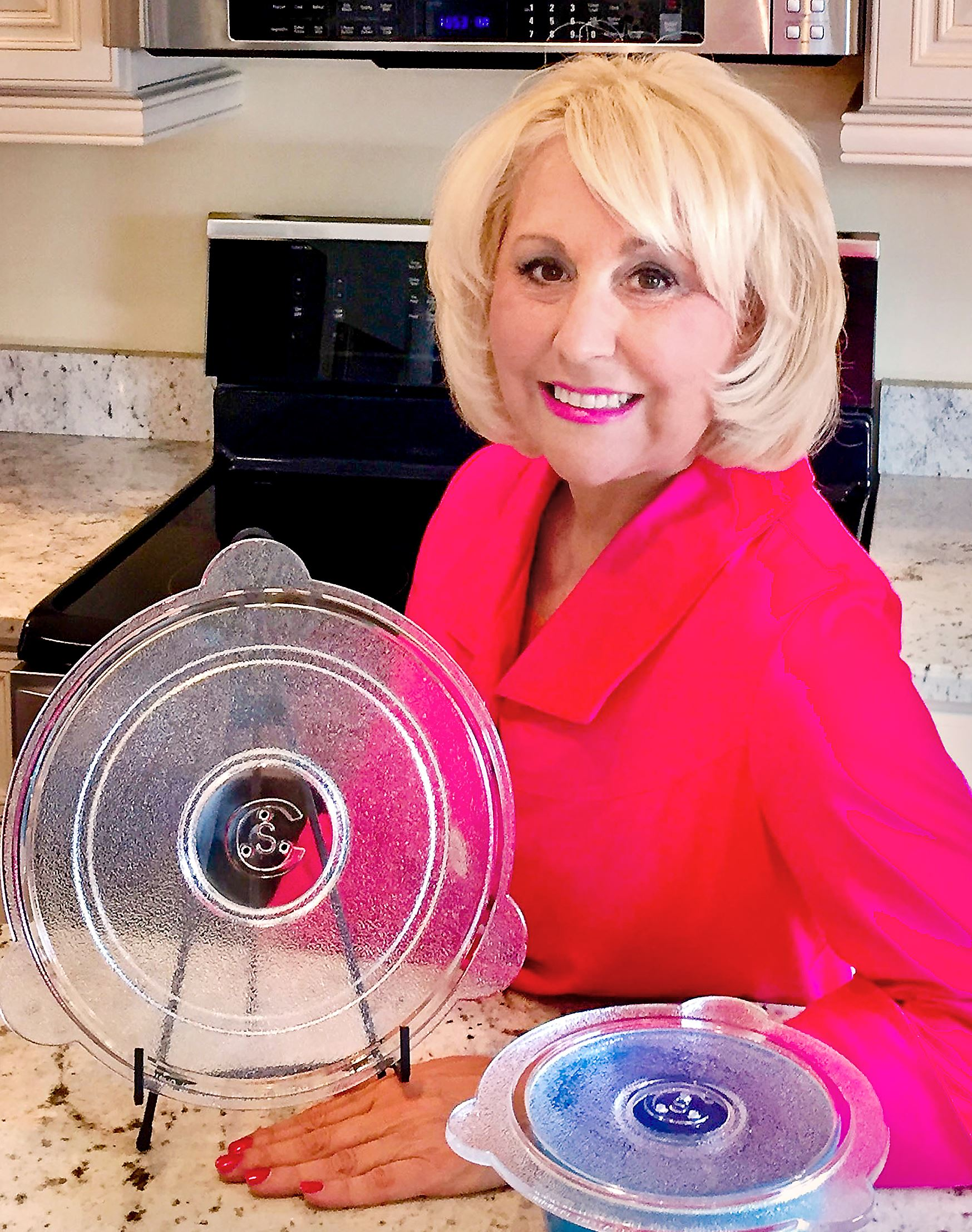 qvclady0127 Susan Castriota of Upper St. Clair with the Cuchina Safe Universal Glass lid she invented and will sell on QVC.