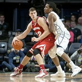 Wisconsin's Ethan Happ backs down Penn State's Brandon Taylor in Thursday night's win for the Badgers at Bryce Jordan Center.