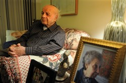 Moshe Baran at his home in Squirrel Hill in 2016. Portraits of his family and his wife sit on an end table near the couch. The first presentation will feature Mr. Baran and his daughter, Avi Baran Munro.