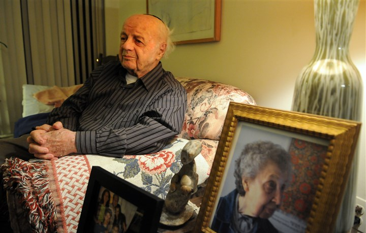 20160121JHLocalBaran02-1 Moshe Baran, 95, at home in Squirrel Hill. Portraits of his family and his wife sit on an end table near the couch.
