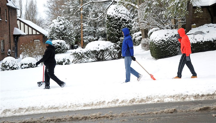 20160123ppSnowWorkLOCAL Bob Jones, Jason Martin, and Robert Smith from Homewood walk along Homewood Avenue in Pt. Breeze looking for some shoveling work Saturday.