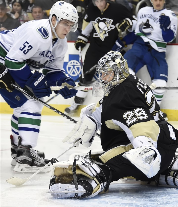 20160123pdPenguinsSports02 Penguins' Marc-Andre Fleury makes a toe save on Canucks' Bo Horvat in the second period at the Consol Energy Center.