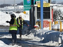 Turnpike workers prepare to open the Somerset interchange to westbound traffic last month.