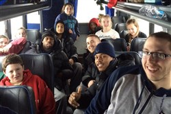 The Duquesne men's basketball team with some students from another vehicle as they are all immobilized by snow on the PA Turnpike.