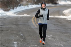 Hannah Camic makes her way down River Avenue while training for the Pittsburgh Marathon. Ms. Camic was born with cystic fibrosis and struggles on a daily basis to keep her lungs clear to breathe.