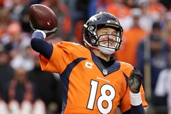 Denver Broncos quarterback Peyton Manning passes during the second half of the NFL football AFC Championship game between the Denver Broncos and the New England Patriots, Sunday, Jan. 24, 2016, in Denver.