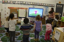 Using a smartboard, teacher Alexis Pavolik leads her preschoolers in counting numbers at Allegheny Intermediate Unit Head Start in Carnegie.