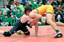Upper St. Clair's Eli Grape, left, wrestles Francis Duggan of North Allegheny in the 195-pound final of the Allegheny County Tournament this past weekend. Grape earned a 3-2 victory. Photo by Susan Wentzel, Tri-State Sports & News Service
