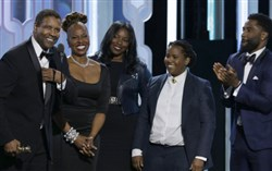 Denzel Washington, far left, accepts the Cecil B. Demille Award with his family during the 73rd Annual Golden Globe Awards ceremony in Beverly Hills Jan. 10.