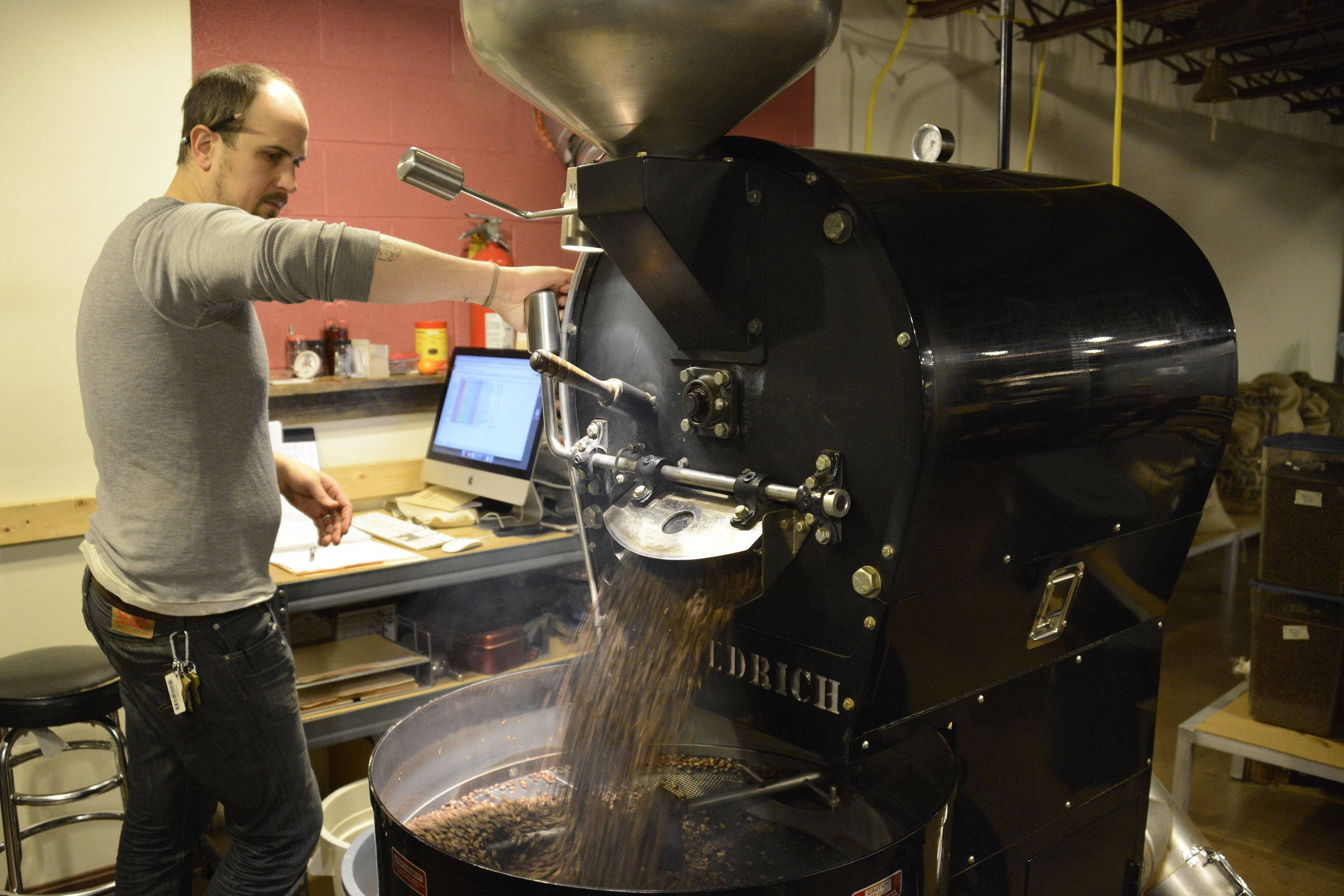 "20160125dsCoffeehouse0127Food01 Phil Johnson of East Liberty releases the freshly roasted coffee beans from the roaster at Commonplace Coffee in Larimer. The ""Diedrich "" roaster raises the beans to 415 degrees."