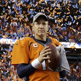 Denver Broncos quarterback Peyton Manning holds his game ball during the trophy presentation after their AFC championship win against New England.