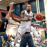 Duquesne's Derrick Colter drives to the net against La Salle in the first half Tuesday night at Palumbo Center.